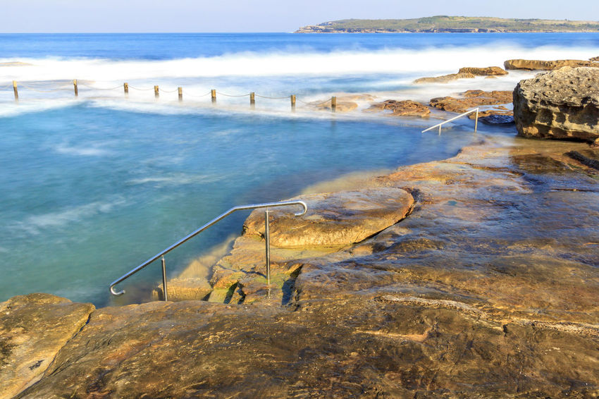 Slow down capture of the Mahon Rock Pool, with smooth waves and water. The railing leading in the pool is visible. Swimming Animal Themes Beach Beauty In Nature Day Horizon Over Water Mahon Pool Nature No People One Animal Outdoors Pool Rock Pools Scenics Sea Sky Swimming Pool Travel Destinations Water