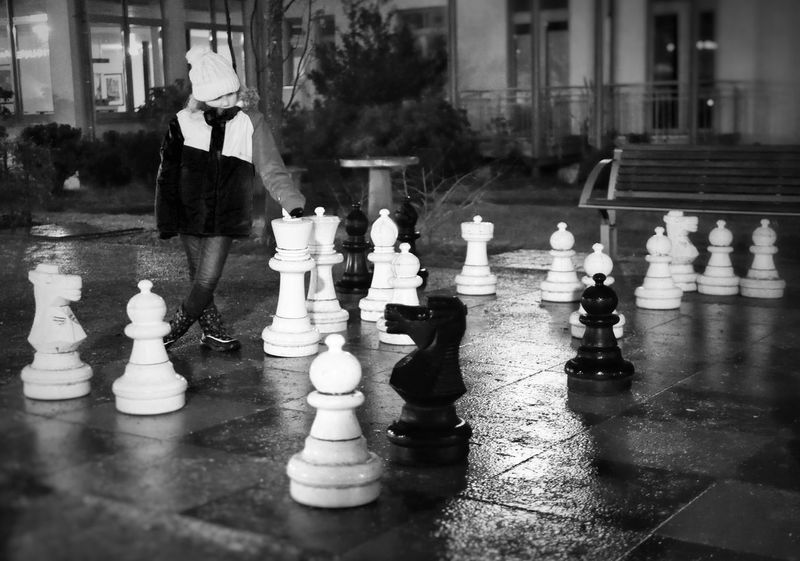 White vs. Black MAinLoveWithFreedom and Little Girl Playing Chess Chess Game Thinking Think Thoughts Thoughtful Deep Thoughts Monochrome Black And White Bnw Bnw_collection Bnw_captures Bnw_maniac Bnw Photography Urban Street Street Photography Streetphoto_bw Children Children Photography Big And Small How I See The World