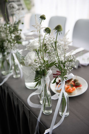 Wedding table setting and flora details,meal,place settings,centerpiece, floral arrangement