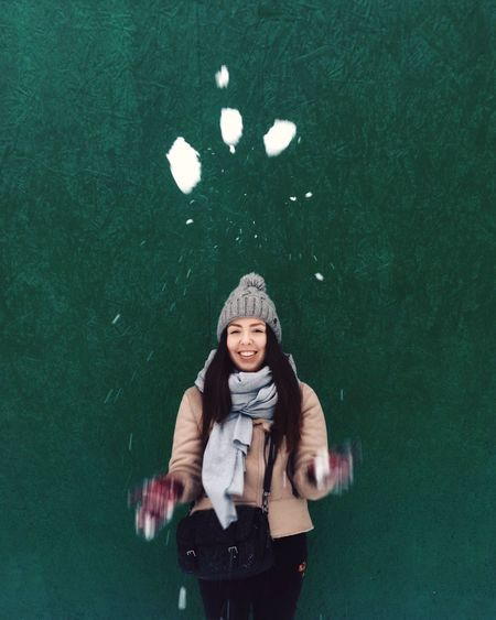 Portrait Of Woman Throwing Snow
