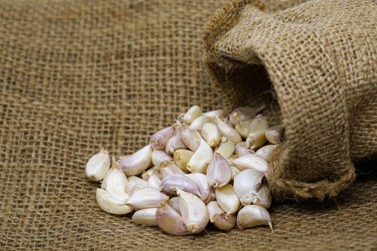 garlic in sack bag Cooking Garlic Medicine Close-up Food Freshness Healthy Eating Sack Sack Bag