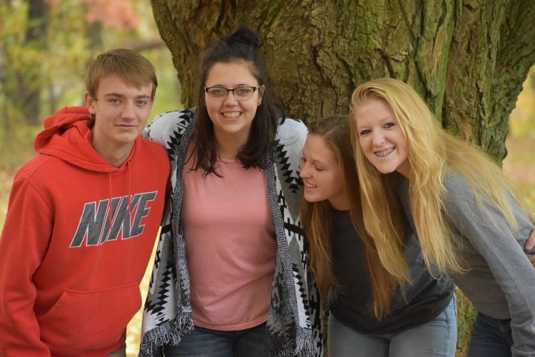 Cousins Tree Teenage Girls Togetherness Tree Trunk Day Teenager Front View Real People Smiling Outdoors Leisure Activity Standing Portrait Young Women Nature Looking At Camera Forest Young Adult Lifestyles Happiness