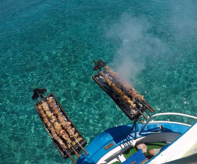 High angle view of barbecue meat on boat in sea