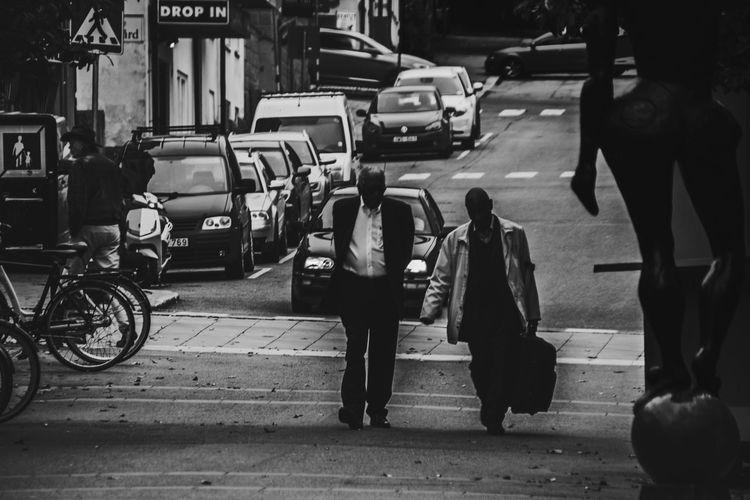Monday morning. Back to work. EyeEm Best Shots EyeEm Selects EyeEmNewHere Adult Bicycle Blackandwhite Blackandwhite Photography Building Exterior Car City City Life City Street Day Full Length Land Vehicle Men Mode Of Transport Outdoors People Real People Road Street Transportation Walking Women EyeEmNewHere