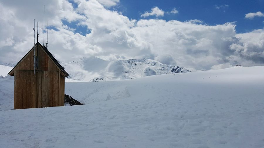 Wooden Shed and Alpine Landscape. Independence Pass Colorado Rocky Mountains Alpine Alpine Landscape Snow Winter Spring Springtime In Colorado May Colorado Travel Hiking Adventures Outdoors Wooden Shed Outpost Weather Station Space For Copy Mountains And Sky Blue Sky Natural Light Environment