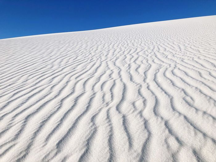Sand and Blue Sky Sand Dunes White Sands National Monument New Mexico Blue Sand Land Pattern Scenics - Nature No People White Color Climate Environment Backgrounds Beauty In Nature Landscape Sky Nature Extreme Terrain Outdoors Day