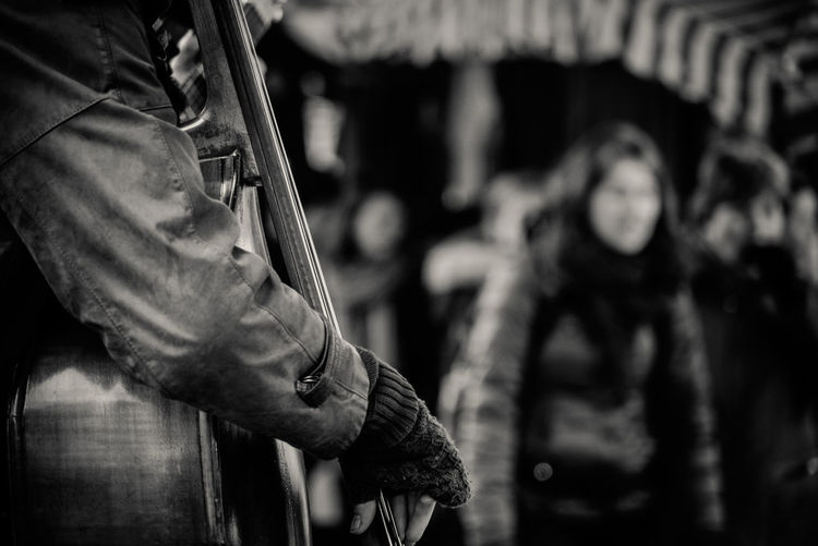 Close-Up Of Person Playing Double Bass