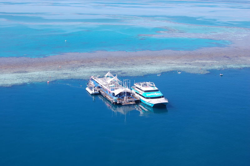 Outer Great Barrier Reef activity platform Queensland Australia Water Transportation Nautical Vessel Sea Mode Of Transportation High Angle View Waterfront Ship Day Nature Blue Beauty In Nature Scenics - Nature Travel Tranquility Outdoors Tranquil Scene Moored Passenger Craft Turquoise Colored Outer Great Barrier Reef Activity Platform Great Barrier Reef Outer Reef Reef Tours Snokeling Scuba Diving Australia Queensland