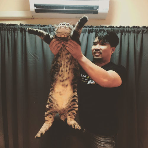 Full length of a boy with cat