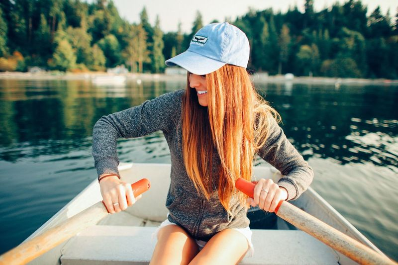 Young Woman Rowing On Sea At Orcas Island