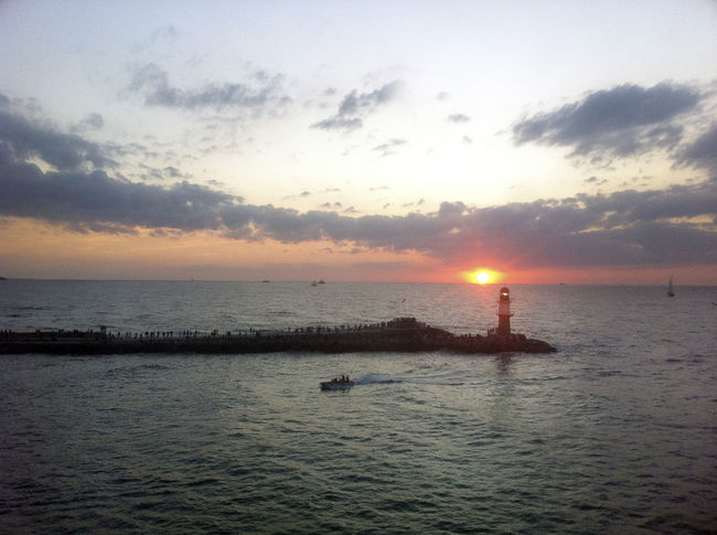 Beach Beauty In Nature Cloud - Sky Day Group Of People Horizon Over Water Lighthouse Nature Nautical Vessel No People Outdoors Scenics Sea Silhouette Sky Sun Sunlight Sunset Tranquil Scene Tranquility Water Waterfront Wave