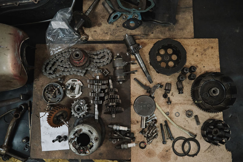 High angle view of old machine part on table