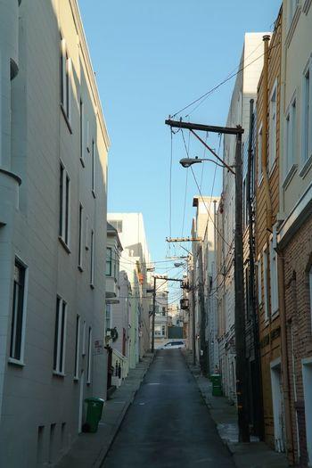 Empty Street Amidst Buildings