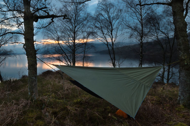 Hammock Camping at Sunset Camping Scotland Trossachs National Park Wild Camping Bare Tree Beauty In Nature Dusk Forest Hammock Lake Land Nature No People Non-urban Scene Outdoors Plant Reflection Scenics - Nature Sky Sunset Tranquil Scene Tranquility Tree Water Wilderness