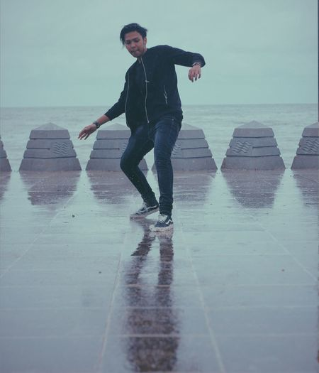 Dance Wetfloor Rainy Days Cloudy Day Beach Beach Walk One Person Men Photooftheday Be. Ready. Photography Photographer Leisure Activity Lifestyles EyeEmNewHere With Friends Hangouts  Portraiture Portrait Photography Canon Outdoors Reflection Reflections In The Water
