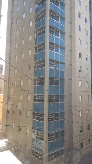 Window Modern Water Business Finance And Industry Sky Architecture Building Exterior Built Structure Office Building Tall - High High Rise Infrastructure Tower Office Building Exterior Building Building Story