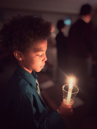Blurred Background One Boy Candle Light Service Candlelight Candle Burning One Person Illuminated Indoors  Night Flame Real People Candle Focus On Foreground Side View Holding Close-up Well-dressed Young Adult