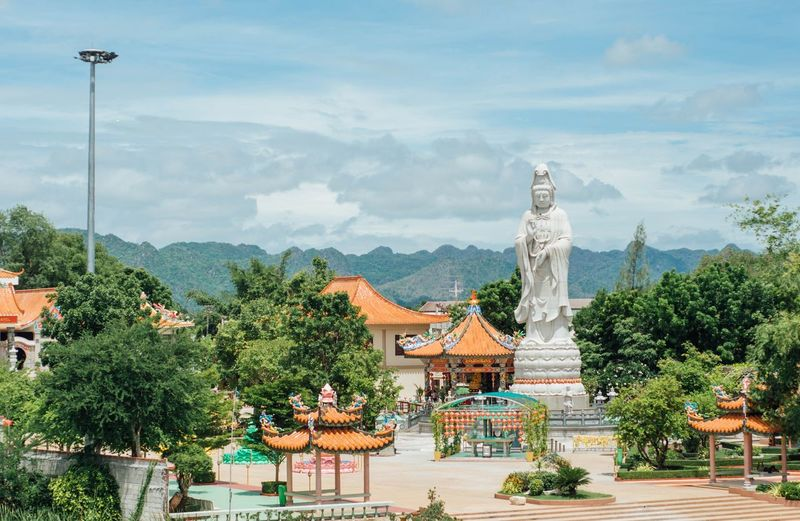 Huge buddhist statue in kanchanaburi against sky