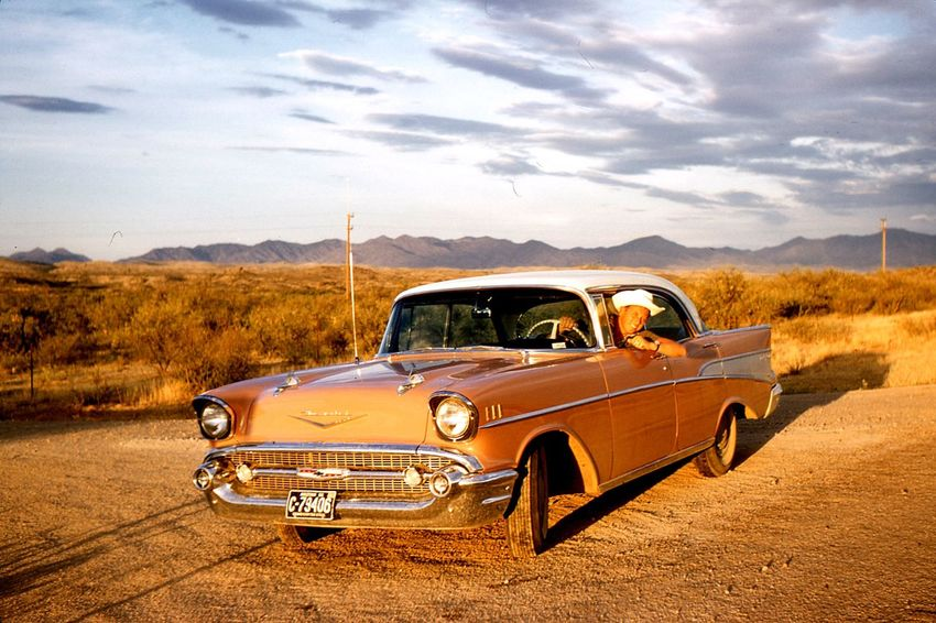 Somewhere in Arizona July 1957. Grandfather behind the wheel like a cowboy. Oldpicture Vintage Cars Chevy Sunset Desert Arizona Countryside Car Family United States