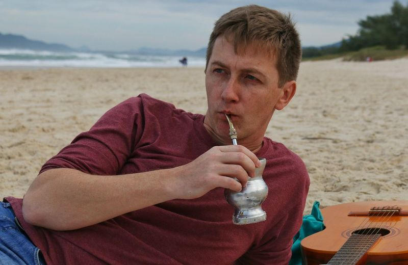 man drinking mate-tea on the beach Argentina Beach Beach Time Beachphotography Casual Clothing Drinking Enjoyment Focus On Foreground Freshness Holding Leisure Activity Looking At Camera Man Non-urban Scene Person Sand Sea Shore Summer Tereré Tourism Tourist Vacations Water Young Adult