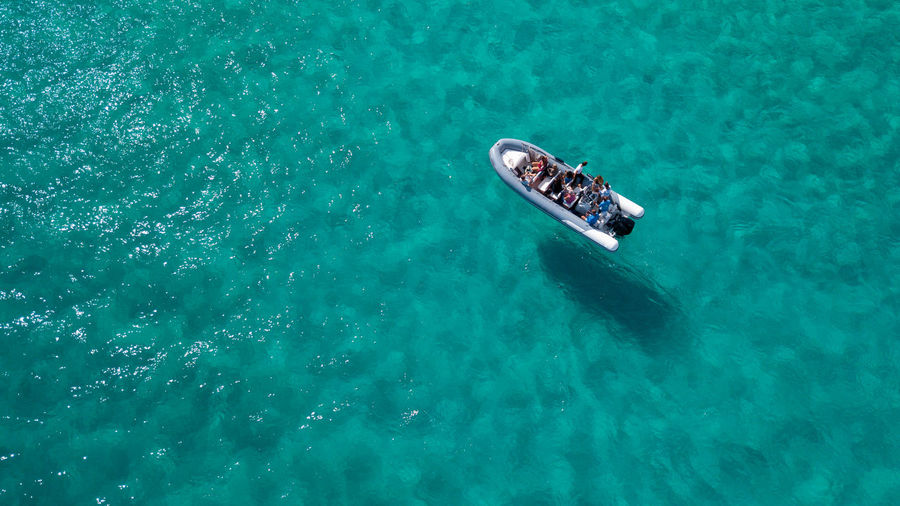 Water High Angle View Waterfront Sea Nature Day Turquoise Colored Transportation Outdoors Swimming Leisure Activity Nautical Vessel Mode Of Transportation Beauty In Nature Real People Sport Blue Underwater Men