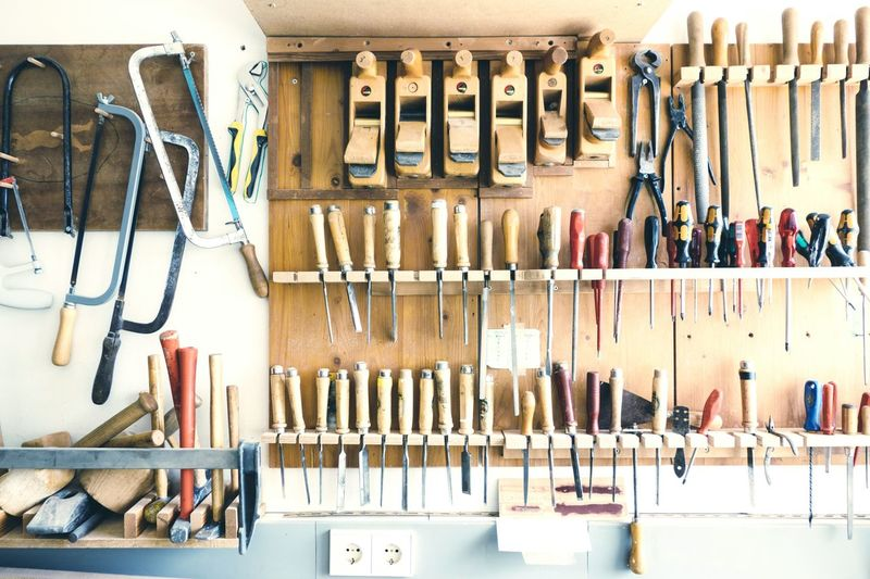 Tools on rack at workshop