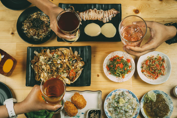 Japanese Food Alcohol Beer Glass Bowl Directly Above Drink Drinking Glass Food Food And Drink Freshness Healthy Eating Holding Human Body Part Human Hand Indoors  Leisure Activity Lifestyles Meal Men Plate Ready-to-eat Real People Refreshment Serving Size Table