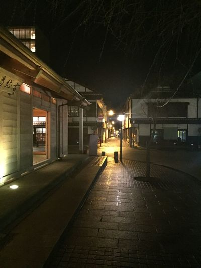 Empty illuminated street lights at night