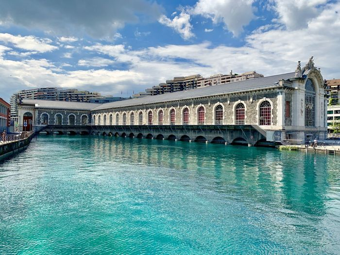 Geneva Old industrial river turbine-house Cloud - Sky Sky Architecture Built Structure Water Building Exterior Waterfront Nature No People Day Travel Destinations Travel Building Tourism Arch Outdoors Reflection City Turquoise Colored House Turibne, River Turquoise