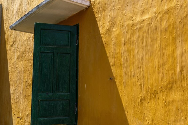 Close-up of yellow door of house