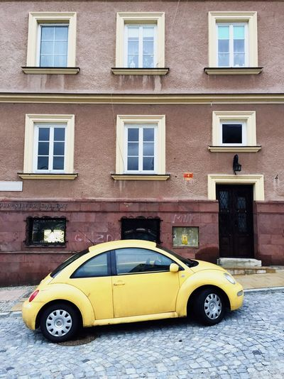 Architecture Car Building Exterior Motor Vehicle Built Structure Yellow Mode Of Transportation Transportation Window City Building No People Land Vehicle Day Residential District Street Outdoors Taxi Road Luxury Minimal Minimalism Minimalobsession Retro Styled Retro Style