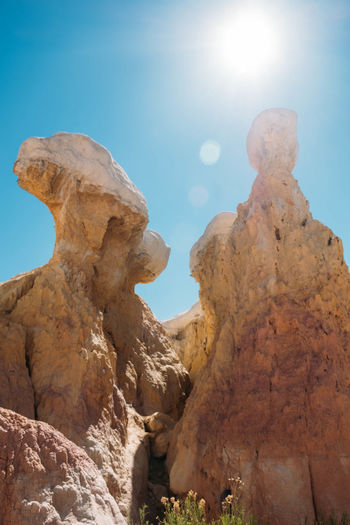 Rock Sky Rock - Object Rock Formation Sunlight Solid Lens Flare Nature Tranquility Beauty In Nature Day Low Angle View Scenics - Nature Physical Geography Tranquil Scene No People Sunbeam Geology Sun Mountain Outdoors Eroded Bright Arid Climate Climate