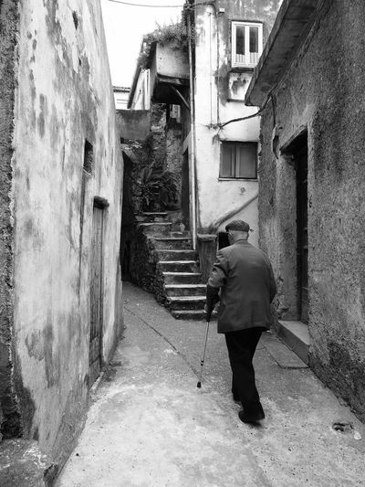 Glimpse with old man Black & White Italia Old Man South Italy Adult Adults Only Architecture Black And White Black And White Photography Building Exterior Buildings Built Structure Calabria Full Length Glimpse One Person Outdoors People Real People Rear View Senior Adult Standing Travel Destination Verbicaro