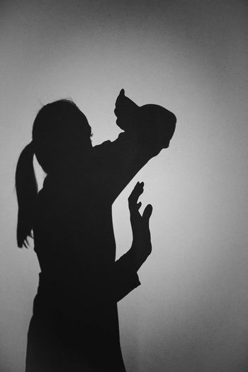 Silhouette couple standing against clear sky