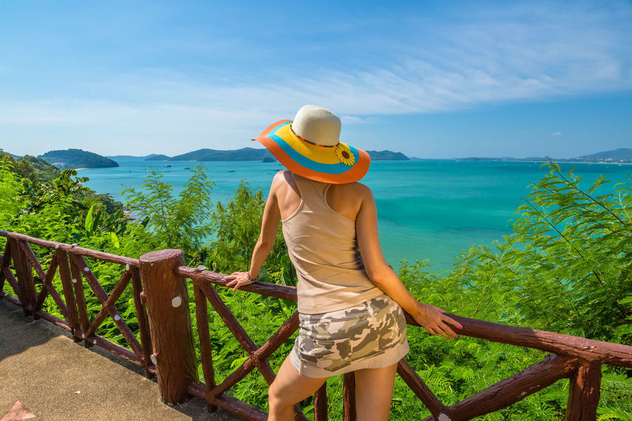 Back of happy and fashionable tourist woman with colorful sarong in turquoise water of Maya Bay famous lagoon of The Beach movie, Phi Phi Leh, Andaman Sea in Thailand Fashionable and happy tourist with sarong and pink wide-brimmed hat making a selfie on tropical famous beach of Nai Harn Beach, Rawai, Phuket, Thailand. Happy tourist enjoys panorama from Sail Rock View Point of kor 8 of Similan Islands National Park, Phang Nga, Thailand, one of the tourist attraction of the Andaman Sea. Happy woman with bikini and shorts, jumping in the air on Ya Nui Beach, a little cove divided by a rocky cape, Phuket, Thailand, Asia. Happy Koh Rok Islands Nui Beach Phang Nga Bay Phuket Thailand Tanning ☀ Thailand Vacations Woman Beach Beauty In Nature Casual Clothing Day Full Length Girl Koh Rok Leisure Activity Lifestyles Mountain Nature One Person Outdoors People Phang Nga Rawai Real People Rear View Scenics Sea Seascape Sky Standing Sunlight Surin Islands Three Quarter Length Travel Destinations Tree Water Women Young Adult Young Women