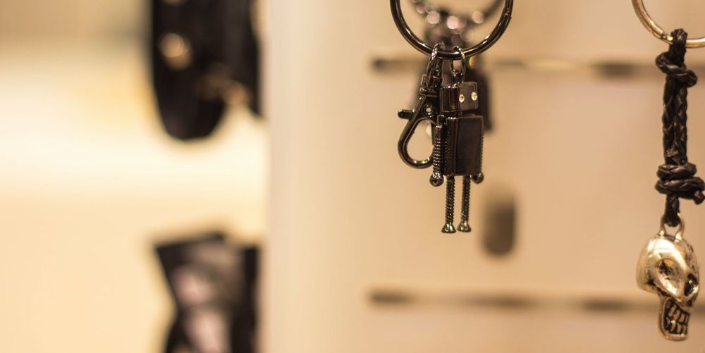 Robot figurine and human skull hanging from key ring