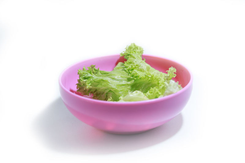 bowl of salad over white background Food And Drink Food Studio Shot Wellbeing Healthy Eating White Background Freshness Green Color Vegetable Indoors  No People Bowl Close-up Cut Out Still Life Herb Ready-to-eat Copy Space Plant Lettuce Vegetarian Food Snack Crockery