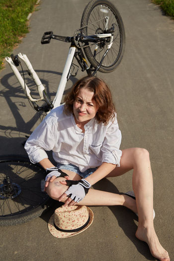 High angle view of woman sitting on bicycle