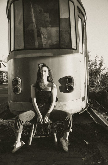 Portrait of woman sitting on train