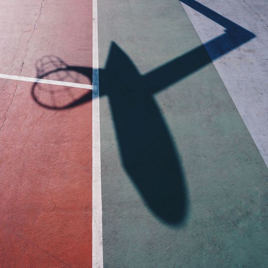 Basketball hoop shadow silhouette on the court on the street