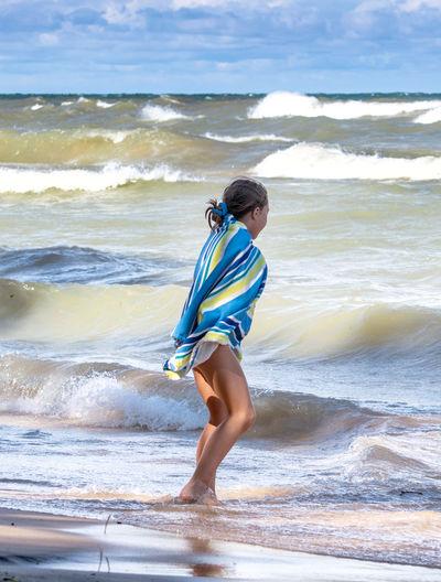 Full length of boy on beach