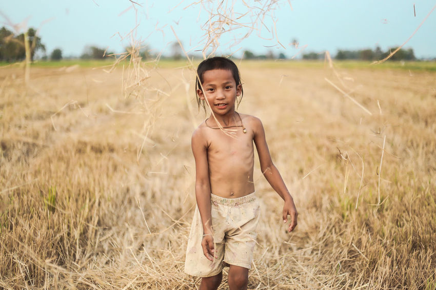 A boy thai ancient hairstyle play in farm Ancient Asian  Beautiful Boy Child Enjoying Life Farm Hair Hairstyle Happiness Kids Klæ Nature Outdoors Outside Phichit Portrait Spring Summer Thailand Traditional Young Adult