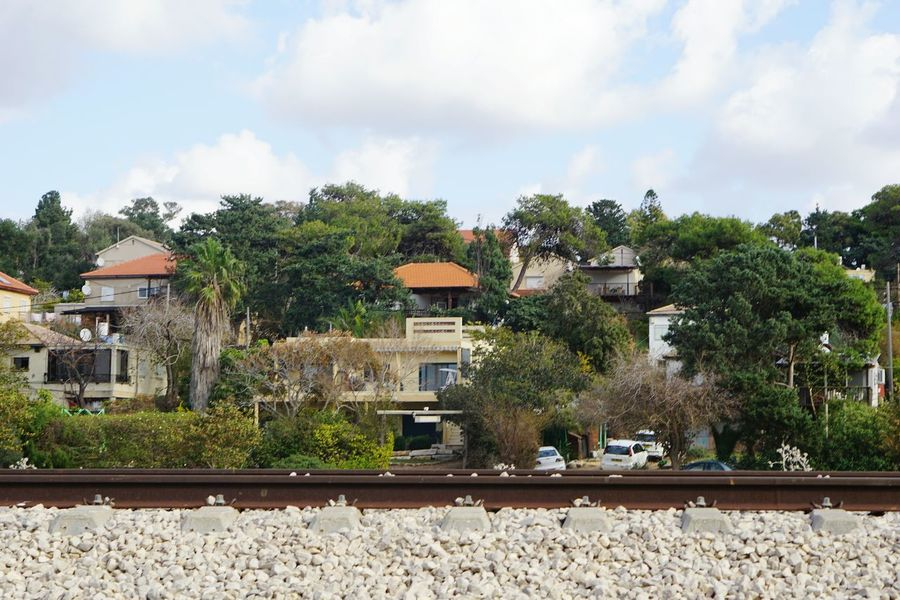 Building Exterior Tree Built Structure House Outdoors Architecture Sky No People Day Nature Train Line Train Lines City Village Adapted To The City Israel Miles Away Stories From The City