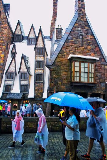 Architecture Summer People USA Outdoors Wizard World Tourist Attraction  Family Time Universal Studios Orlando Harry Potter Harry Potter ⚡ Hogsmeade Tourist USAtrip Orlando Rain Snow Building Exterior Built Structure Orlando Florida Architecture Roof Tops Universal Studios  Togetherness Theme Park