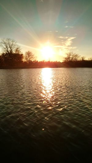 Water Reflection Sunset Sky Sunlight Tranquility Outdoors Beauty In Nature No People Floating On Water Rippled Nature Scenics