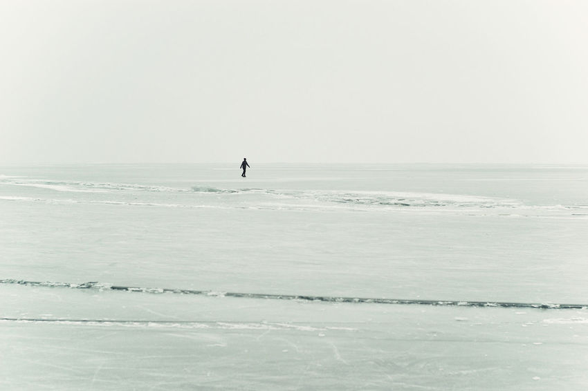 Alone Freshness From My Point Of View Frozen Frozen Lake Frozen Landscape  Frozen Nature Frozen Water Frozen World Ice Field Ice-skating IceField Lake Balaton, Hungary Loneliness Loner Out Outdoor Activities Outdoors Skating Vast Field Winter Winter Outdoor Atmosphere Winter Sports Wintertime