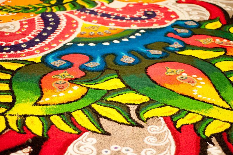 Kolams are drawn and colors are often added during holiday occasions and special events Aripan Celebration Close-up Colorful Decoration Deepavali  Geometrical Patterns Hase Temple Hindu India Kolam Kolamdeepavali Multi Colored Natural No People Ocasion Powder Power In Nature Prosperity Raangolee Raongoli Synthetic Thaipusam