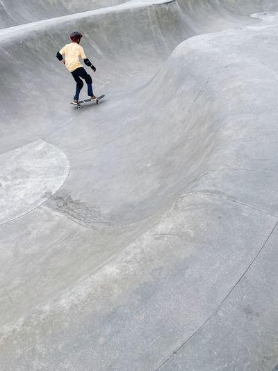 High angle view of man skateboarding on skateboard