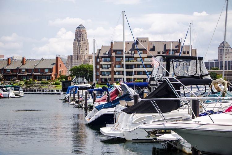 exterior daytime stock photo of buffalo marina with boats in foreground and buffalo city Hall in background Buffalo City Buffalo City Hall Western New York  New York Buffalo Buffalony Erie County City Hall Foreground Cloudy Queen City Waterfront Lake Erie Great Lakes City Water Nautical Vessel Beach Sea Sky Architecture Building Exterior Cloud - Sky Marina Yacht Dock Cityscape Urban Scene Skyline Water Vehicle
