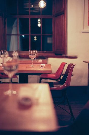 Empty chairs and table in restaurant